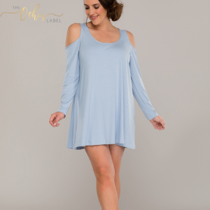 woman in short baby blue loungewear dress by the other label made in great britain. women's clothes made in britain