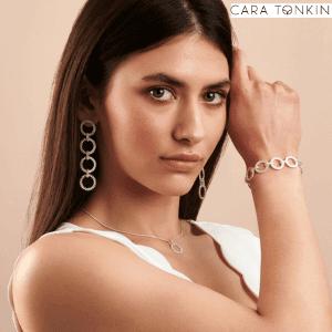 woman wearing cara tonlin silver drop earrings made in Brighton