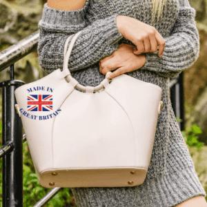 woman in knitted dress holding large beige shopper handbag, british made handbags
