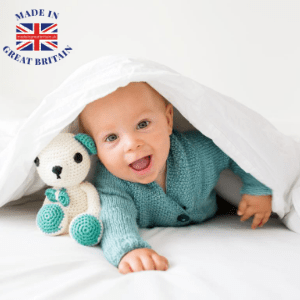 best british baby brands, best uk blog, cute baby hiding under a cover with a teddy bear, made in britain