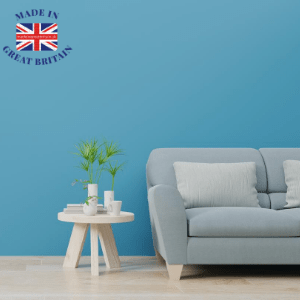 best british furniture brands, made in britain, sofa and side table with blue background, british blog