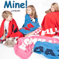 mine london, children sat on floor with towels wrapped around their shoulders, british made kids blankets and towels