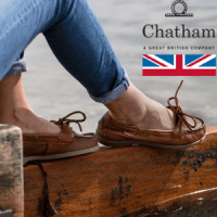 british made women's shoes, woman wearing brown boat soes by chatham marine and denim jeans by the water, made in great britain