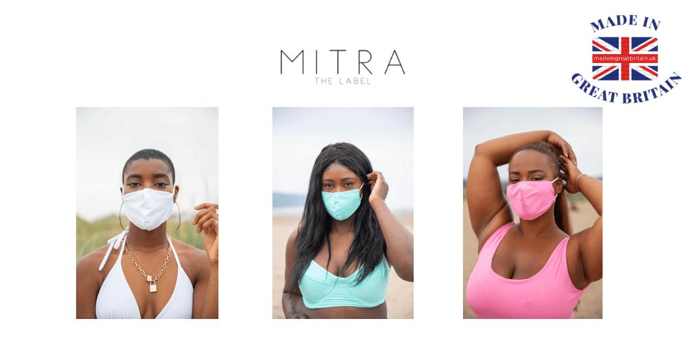 3 black women wearing bikinis and face masks on a beach,