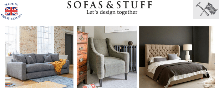 classic modern sofa in living room with small upholstered chair next to set of drawers and a handmade bed with luxury head board made in britain