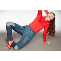 british made womenswear wizard jeans woman wearing jeans and red top