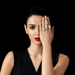 woman holdong hand over her eye wearing several pieces of boodles fine British made jewellery