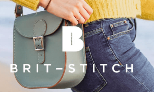 woman wearing jeans and carrying a britstitch milkmans handbag,