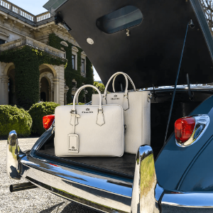 church's luxury leather handbags in boot of a vintage luxury car, british luxury brands