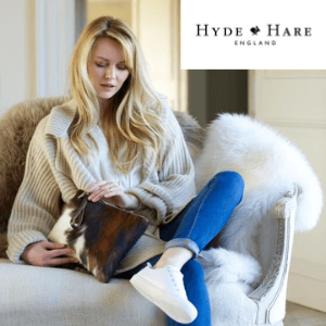 woman with blonde hair holding a hyde and hare luxury cow hyde brown and white hand bag made in britain